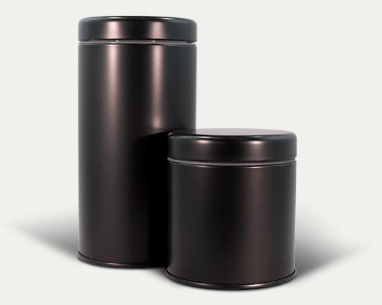Two matte black child resistant LocTin marijuana tins in the large and medium sizes.