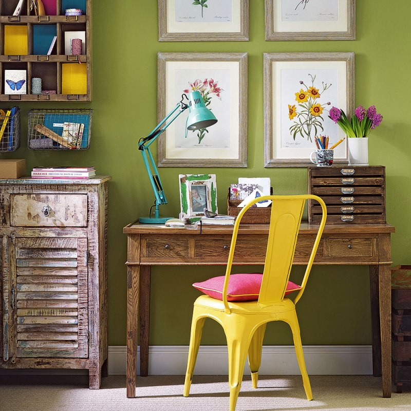 Green botanical home office with wooden furniture