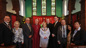 Civic and politician leaders join the Bishop and Rector.