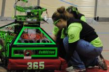 At a competition with our 2012 robot, CoMOEtion. This robot was designed to shoot foam basketballs into hoops.