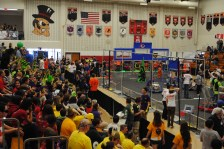 Yeah...the normal craziness at a FRC robotics competition. Notice all the bright green on the left? That's us.