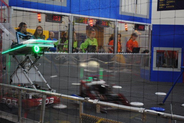 This is me (and a team of 3 other girls) driving our 2013 robot at a competition. (That's me in the middle wearing bright green.) We ended the day winning the 2nd place trophy!