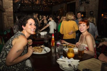 Melissa Hill, food + drink writer, and Lisette Medina, arts writer, take a break to test out the food at Logan Bar. Photo: Kyle Kissell