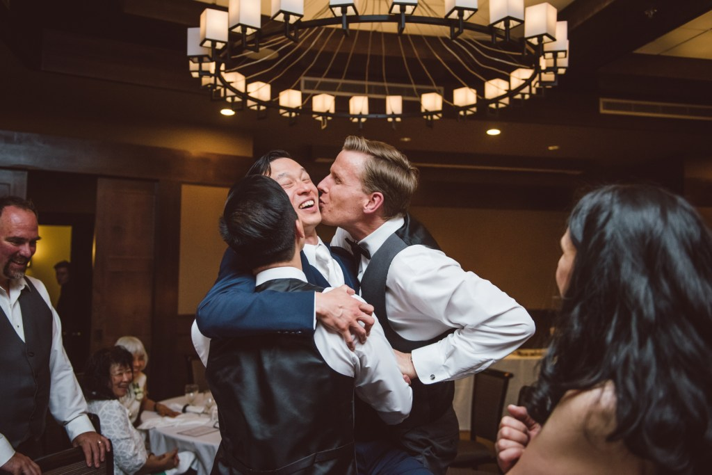 whistler-wedding-photography-party-kiss_LS