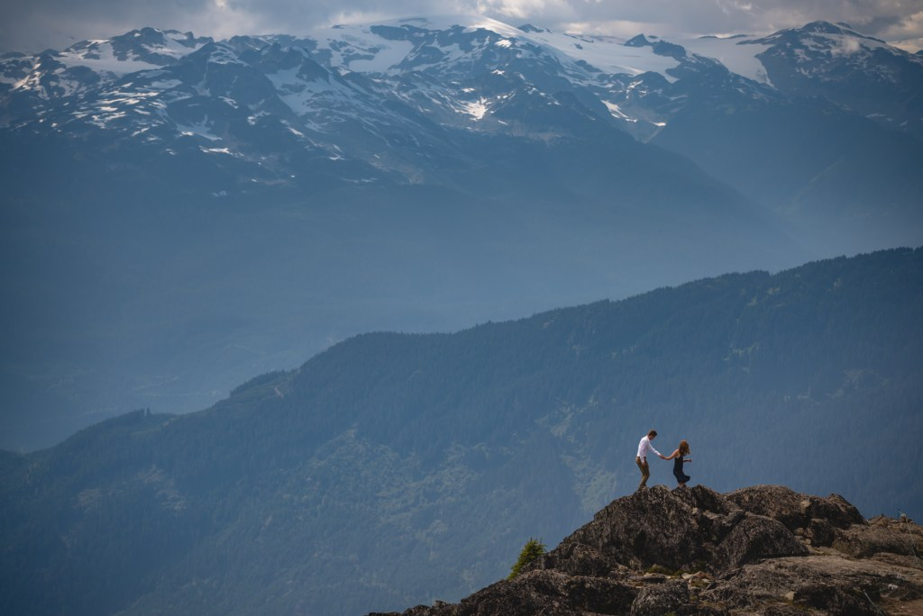 A couple walking on the peak of Whistler mountain