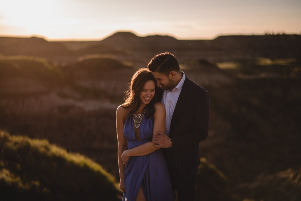 drumheller-engagement-couple-formal-laugh