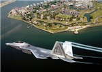 Old Meets New - a USAF F-22 Raptor Soars Over Fort Monroe, Virginia