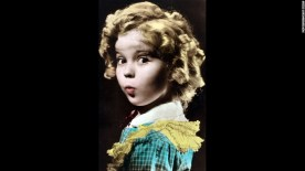 """Cinema, Personalities, circa 1930's, American """"child star"""" film actress Shirley Temple who made her film debut at the age of 3, and during the depression years her blond ringlets and appealing lisp caught the imagination, She often upstaged her experienced co-stars and the 1934 production of """"Bright Eyes"""" saw her perform one of her more famous songs """"On The Good Ship Lollipop"""" (Photo by Popperfoto/Getty Images)"""
