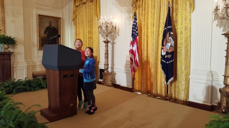 Even on tiptoes, we can't look over the podium in the East Room.!