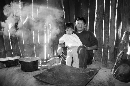 Father & son at the hearth, Belize