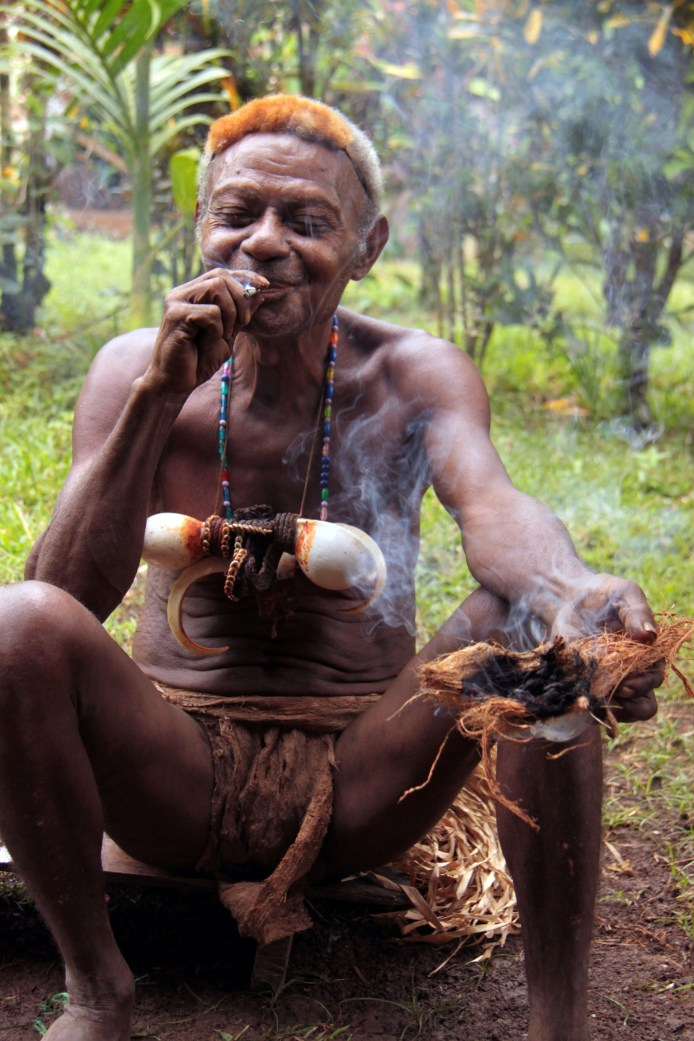 Headhunter enjoying a smoke, Papua New Guinea