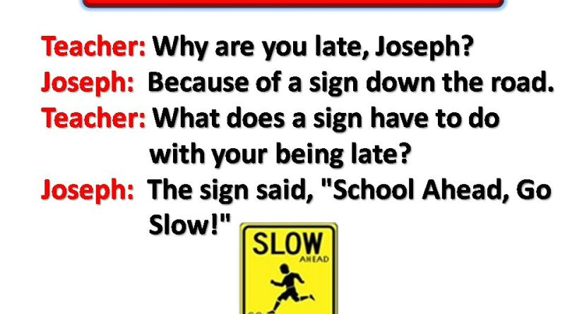 The Sign On The Road Ahead Of School
