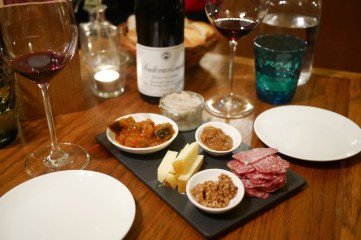 Delicious cheese and charcuterie platter at local cozy wine bar Vinograf (Prague)