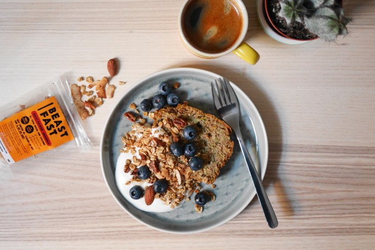 Healthy Zucchini Bread topped with yogurt and BEASTFAST Granola Blueberries