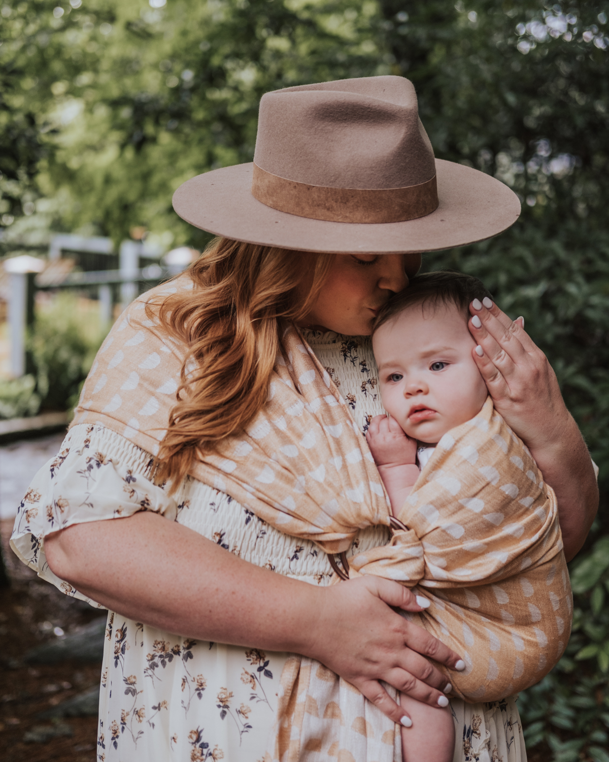 Plus size mom blogger wearing WildBird boho printed ring sling with baby.