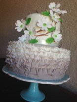 """""""Stacey"""" Ombre ruffle wedding cake in taupe with dogwood flowers."""