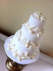 """""""Lauren"""" White on white seashell wedding cake"""