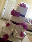 """""""Leann"""" 3 tier square wedding cake with purple ribbon and pink orchids"""