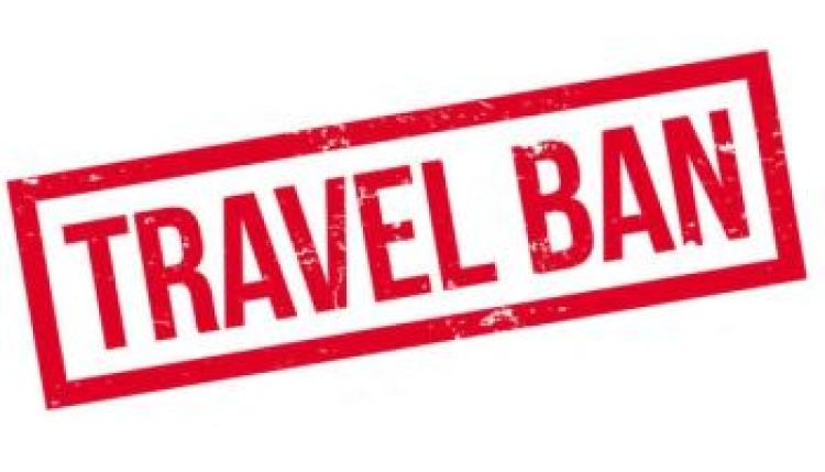"""A stamp of the word """"Travel Ban"""""""