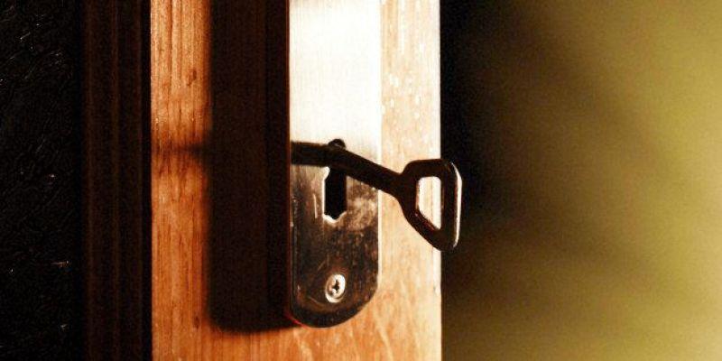 Door left ajar with a key left in the lock