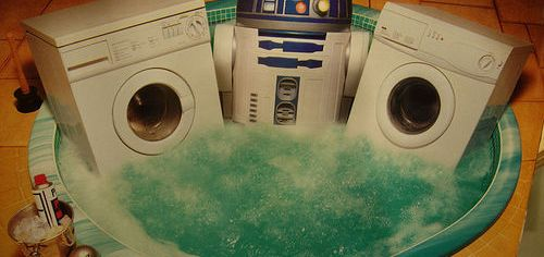 R2D2 in the hot tub with some fine appliances.