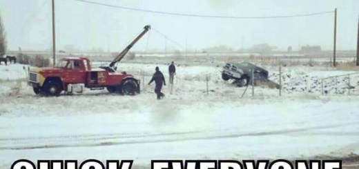 Cars getting pulled out of the ditch.