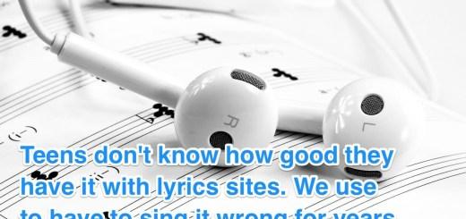 iPhone headphones on music sheets.