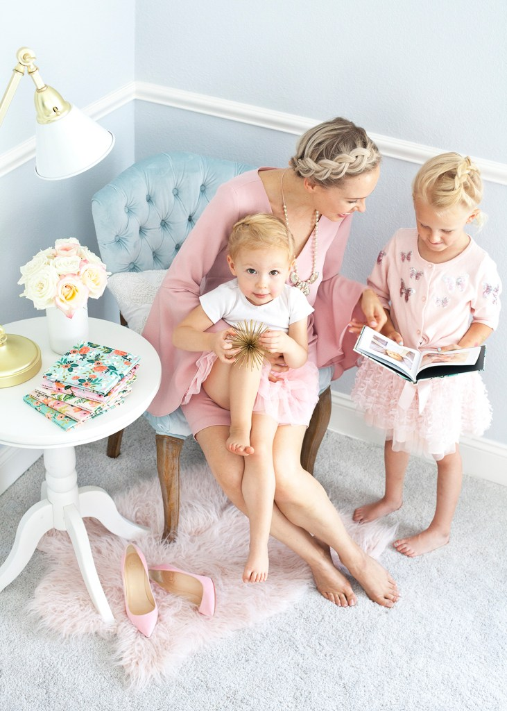 Rifle Paper Co for Chatbooks' floral prints featured by top US life and style blog, Lombard & Fifth: image of a mom and her 2 girls looking at a Chatbooks photo album