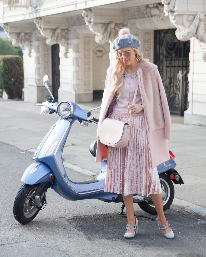 parisian vibes, anthropologie gray blush beret, pleated blush skirt, blush faux fur coat, with a blue scooter