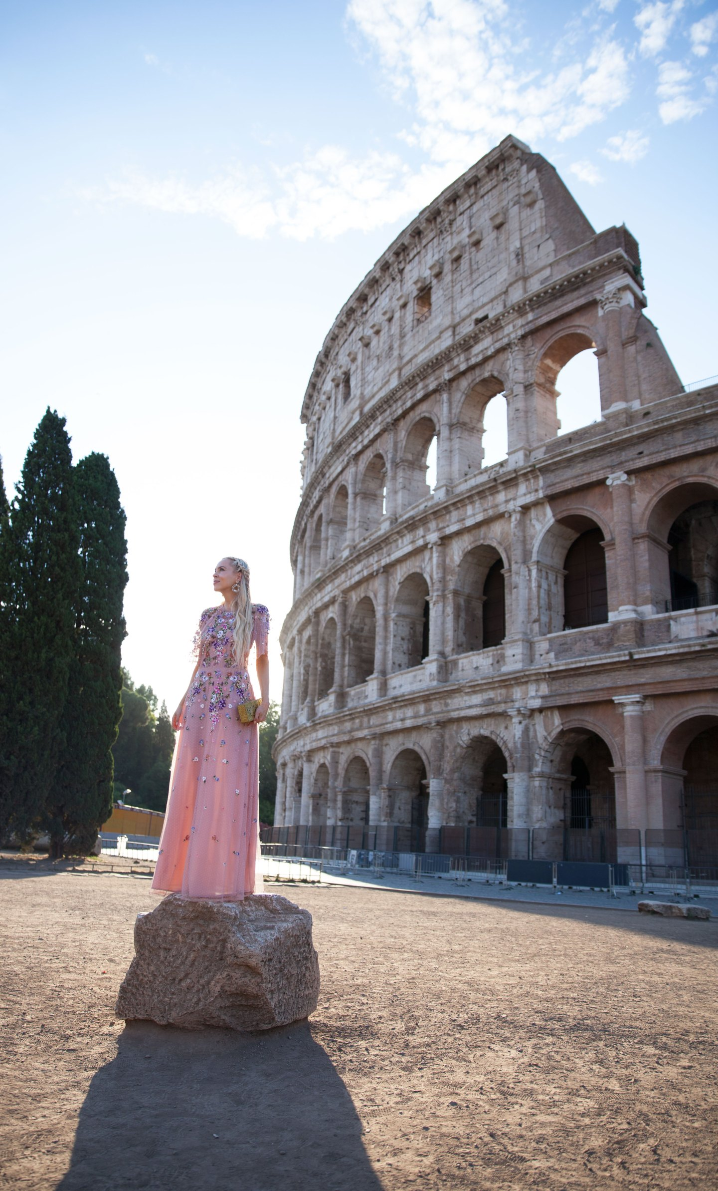 ASOS DESIGN Bridesmaid floral embroidered dobby mesh flutter sleeve maxi dress in Rome  | ASOS floral embroidered maxi dress featured by top San Francisco fashion blog, Lombard and Fifth: image of a blonde woman wearing a floral maxi dress at the Colosseum in Rome