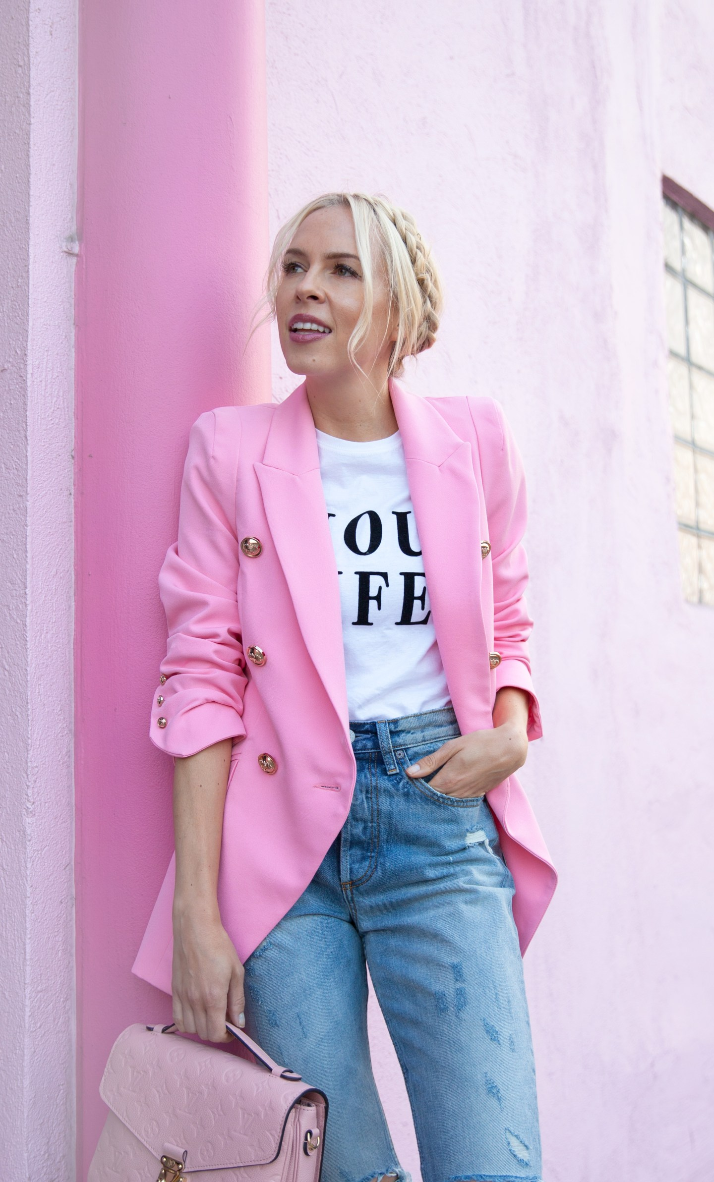 Pink fashion favorites featured by top San Francisco fashion blog, Lombard and Fith: image of a blonde woman wearing a RIver Island pink blazer, denim jeans, pink flats and a pink handbag