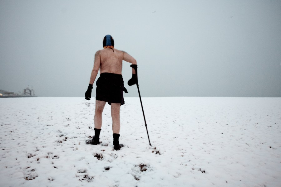 Walking over snow to get to the sea for a swim