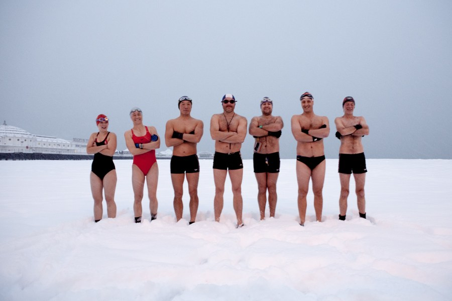 Brighton swimming club members posing in the snow