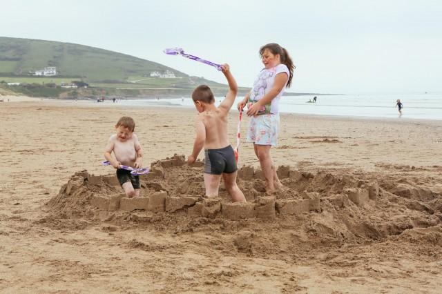 children fighting on a beach