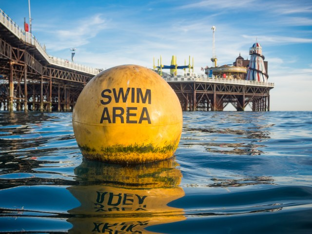 Swim Area Buoy and Brighton Pier by Kevin Meredith
