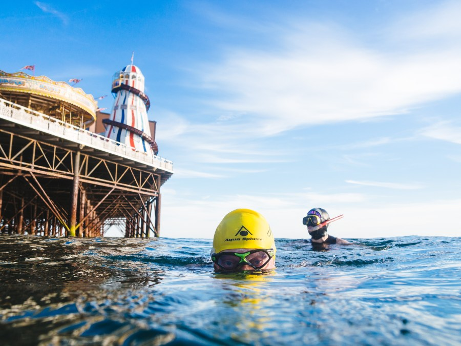 Swimmer near the end of Brighton Pier