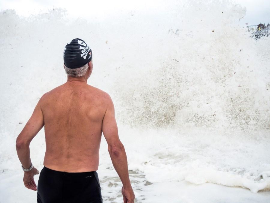 Mike contemplating entering a rough sea.