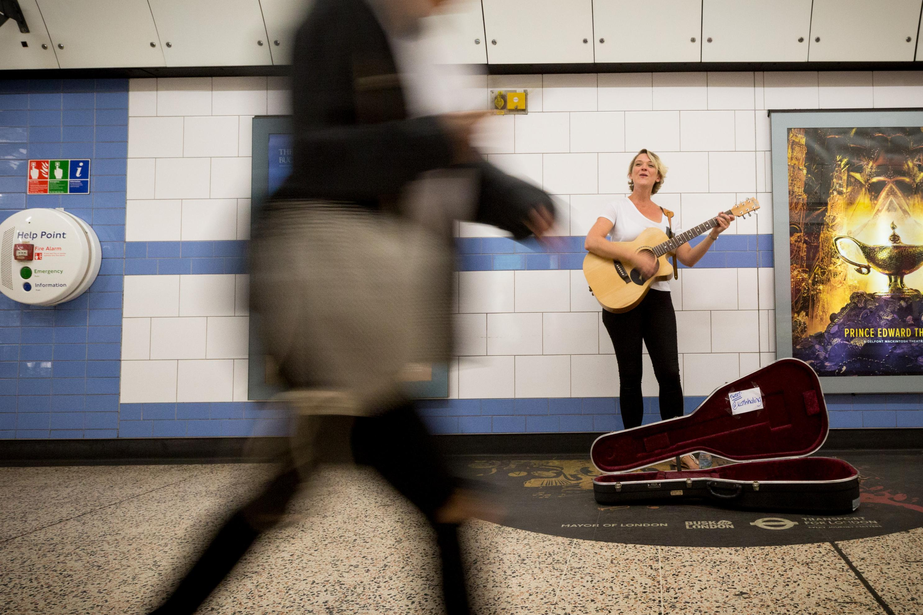 Woman busks at TfL pitch