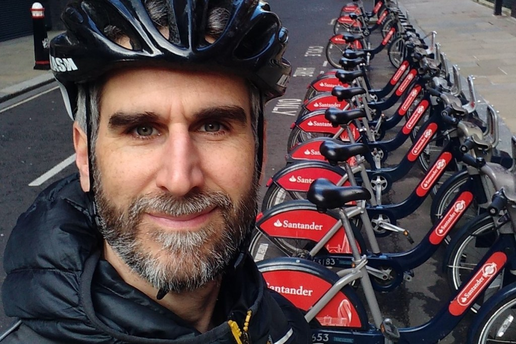 Photo of Andy in front of a Santander Cycles dock