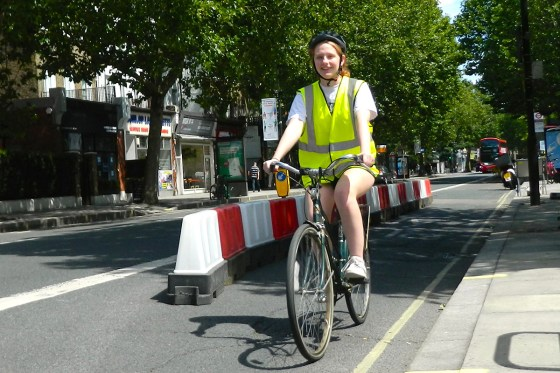 girl cycling next to streetspace scheme