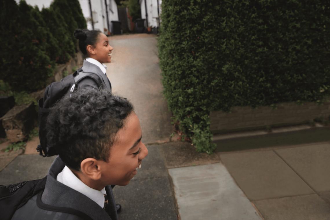 two kids walking to school