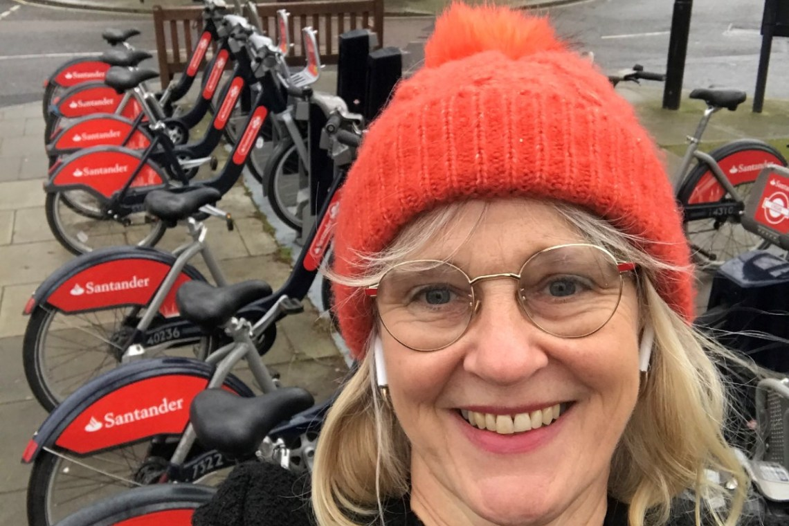 Jess at a Santander Cycle docking station