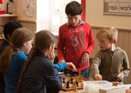 children studying chess