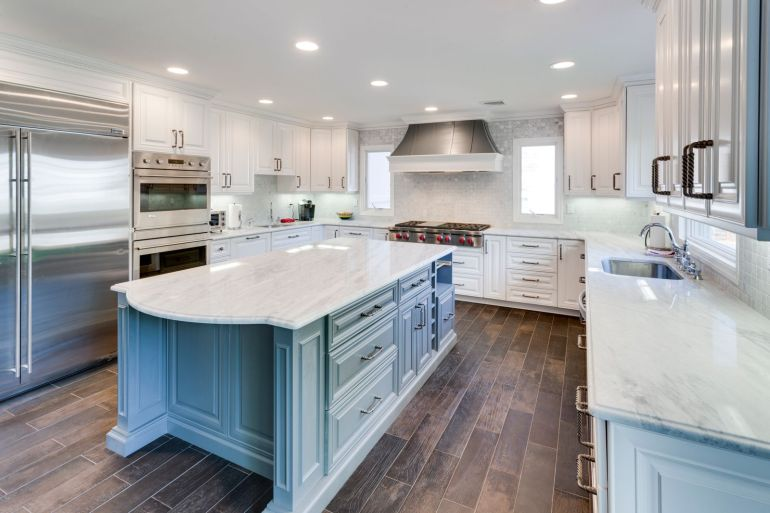 How To Coordinate Your Kitchen Island And Cabinets - Image From HouseTipster.com
