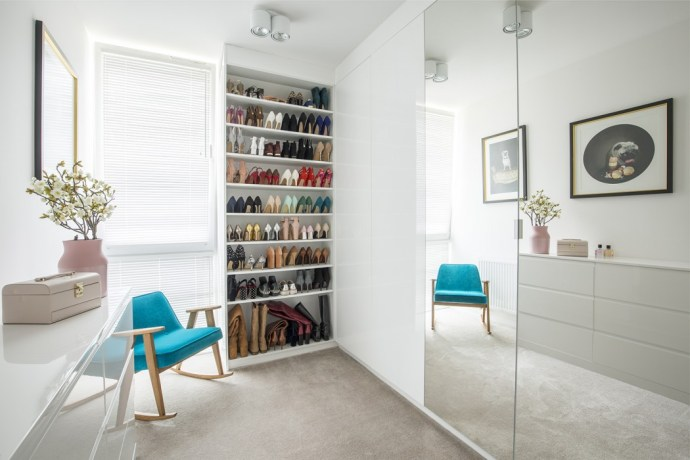 Glass wadrobe doors, blue scandinavian chair and shoe storage cupboard