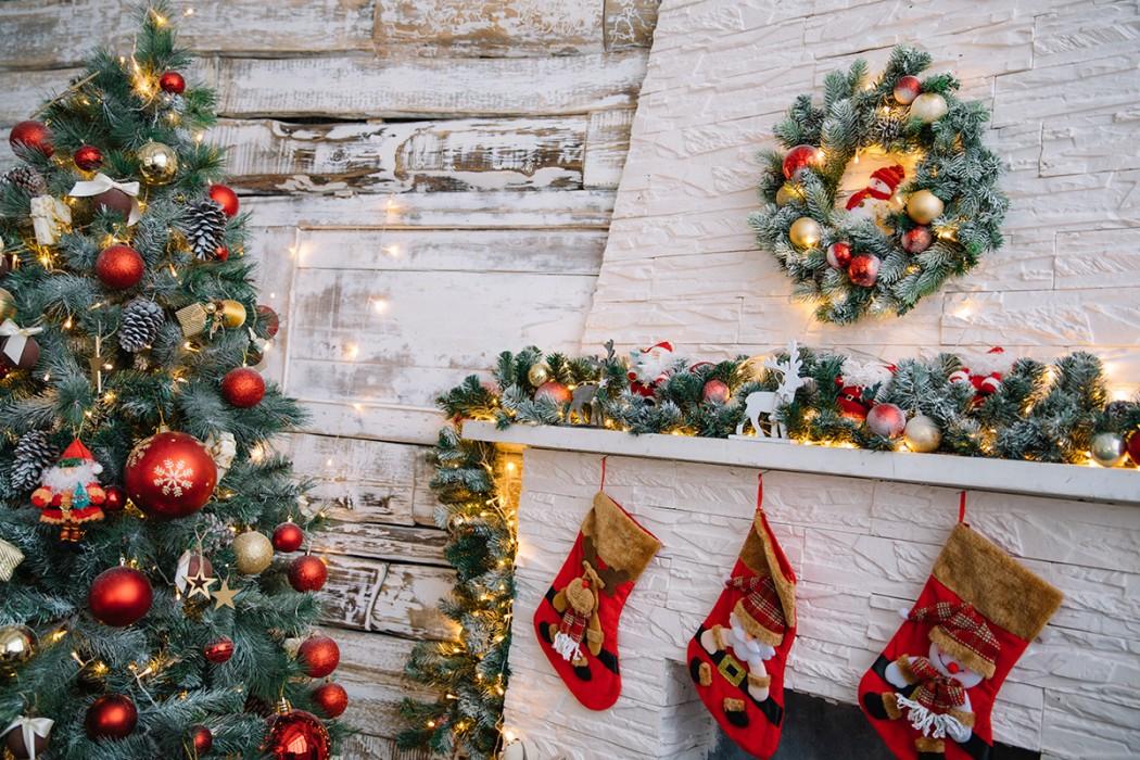 Christmas tree, Christmas Stockings and Christmas wreath by the fireplace