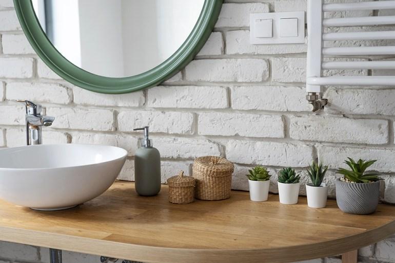 Bathroom sink and round mirror