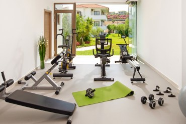 Home gym with view of garden
