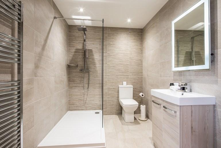 Clean, stylish bathroom with walk-in shower