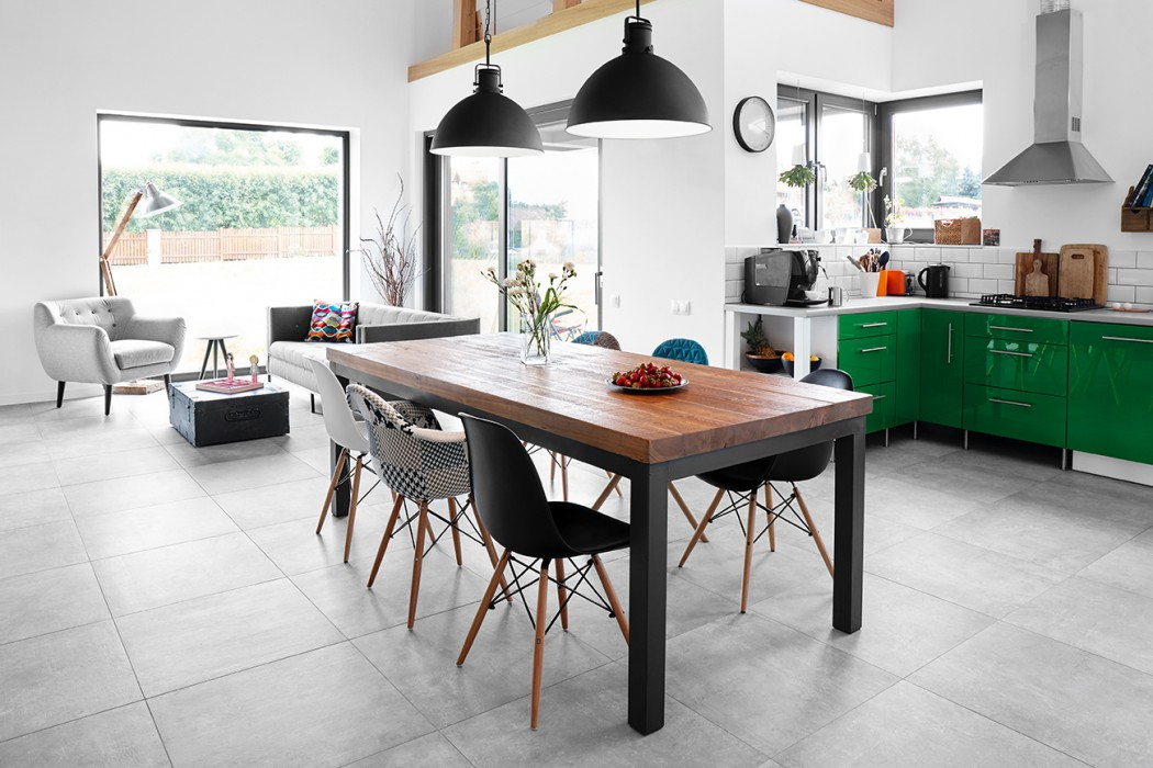 Open plan kitchen, dining room and lounge with grey tile flooring